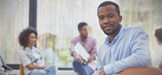 Confident man in group therapy session